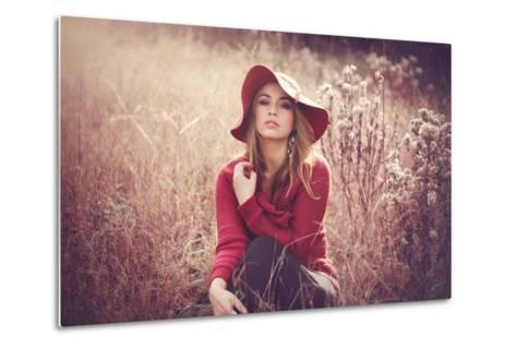 Young Woman Outdoors Wearing a Red Hat-Sabine Rosch-Metal Print