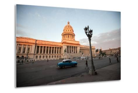 People Walk the Streets and a Classic American Car Drives Past the El Capitolio Building, Havana-Eric Kruszewski-Metal Print