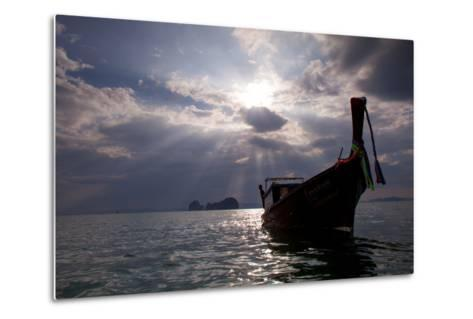 Andaman Sea: A Man Leans Off of a Long Tail Boat in the Andaman Sea under Rays of Light-Ben Horton-Metal Print