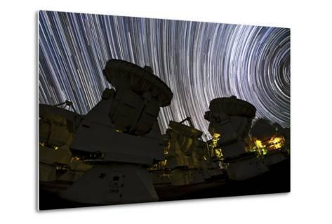 A Time-Exposure Image of Star Trails over the Alma Radio Telescopes, 5000 Meters High in the Andes-Babak Tafreshi-Metal Print