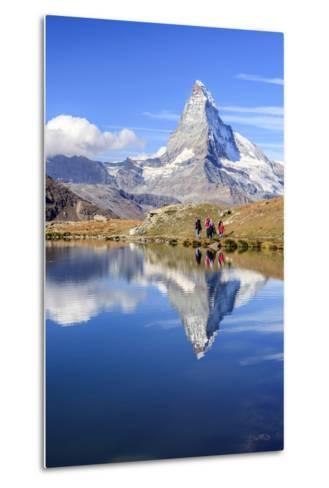 Hikers Walking on the Path Beside the Stellisee with the Matterhorn Reflected-Roberto Moiola-Metal Print