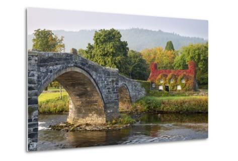 Tu Hwnt I'R Bont Tearoom and Pont Fawr (Big Bridge) in Autumn, Llanrwst, Snowdonia, Conwy, Wales-Stuart Black-Metal Print