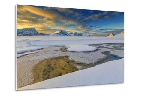 The Golden Sunrise Reflected in a Pool of the Clear Sea Where the Snow Has Melted-Roberto Moiola-Metal Print
