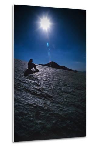 A Hiker Sits on a Glacier Near the Peak of Mount Sialan in the Alborz Mountains of Iran-Babak Tafreshi-Metal Print