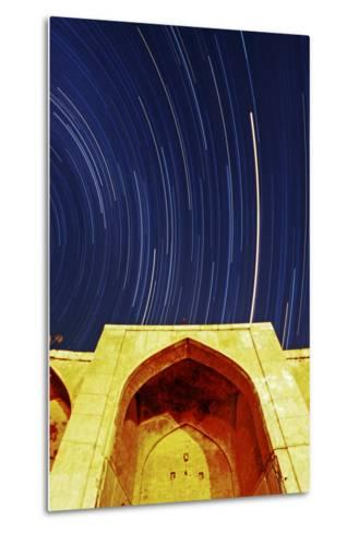 A Time-Exposure of Star Trails Above a Historic Caravansary. the Brightest Trail Is Planet Mars-Babak Tafreshi-Metal Print