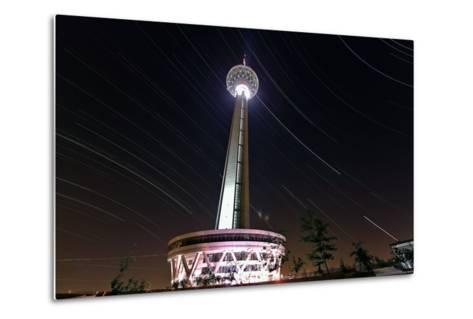 A Three Hour Time-Exposure of Star Trails Above the Milad Communication Tower in Tehran-Babak Tafreshi-Metal Print