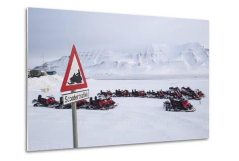 Snow Mobile Traffic Sign in Front of Snow Mobiles-Stephen Studd-Metal Print