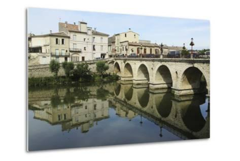 A Roman Bridge, Built in the Reign of the Emperor Tiberius, Spans the River Vidourle at Sommieres-Stuart Forster-Metal Print