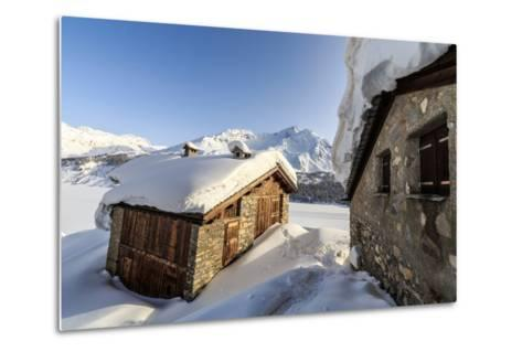 The Sun, Covered with Thin Clouds, Illuminating a Typical Hut Covered with Snow at the Maloja Pass-Roberto Moiola-Metal Print