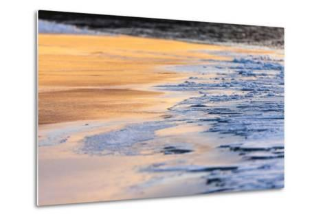 Orange Light from the Sunrise Reflects Off Smooth Ice, Contrasting with the Blue Rough Ice-Jak Wonderly-Metal Print