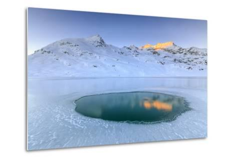 The Piz Cambrena Illuminated by the Sun Reflecting in a Pool Surrounded by Ice at the Bernina-Roberto Moiola-Metal Print