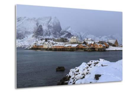 Snowy Peaks and Rorbu, the Red Houses of Fishermen, in the Landscape of the Lofoten Islands-Roberto Moiola-Metal Print