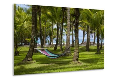 An Empty Hammock Suspended Between Palm Trees Along the Beach Near Parrita-Anand Varma-Metal Print
