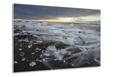 Crystal Clear Icebergs and Volcanic Sand Beach on the Atlantic Shore Near Jokulsarlon Glacier Lake-Babak Tafreshi-Metal Print