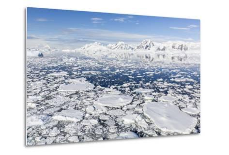 Snow-Covered Mountains Line the Ice Floes in Penola Strait, Antarctica, Polar Regions-Michael Nolan-Metal Print