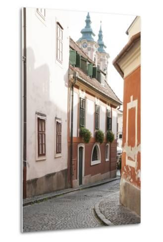 Cobblestone Street and Narrow Buildings with Church Towers in Background, Eger, Hungary-Kimberly Walker-Metal Print