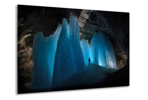 A Caver Is Dwarfed by the Scale of the Ice Formations in Eiskogelhoehle in the Austrian Alps-Robbie Shone-Metal Print