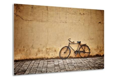 Old Vintage Bicycle Near The Wall-pzAxe-Metal Print