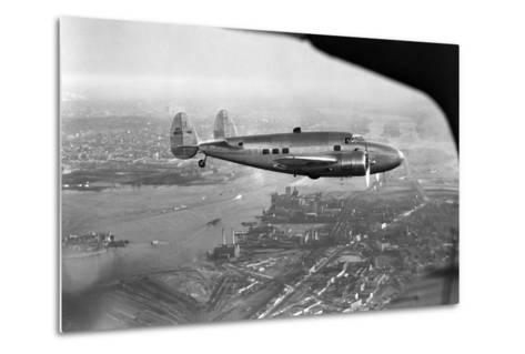 Howard Hughes Lockheed 14 Super Electra over New York City--Metal Print