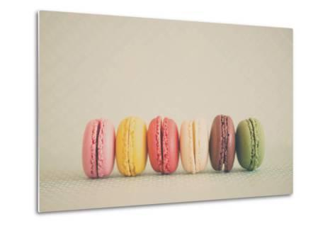 A Rainbow Selection of Sweet French Macarons Sitting in a Row.-Laura Evans-Metal Print