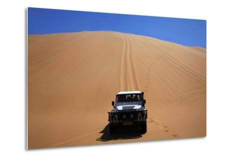 Car Descending a Sand Dune, Namib-Naukluft National Park, Namibia-David Wall-Metal Print