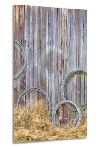 Wire Coiled on Barn Wall, Petersen Farm, Silverdale, Washington, USA-Jaynes Gallery-Metal Print