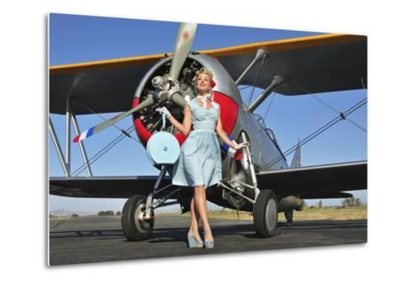 Elegant 1940's Style Pin-Up Girl Standing in Front of an F3F Biplane--Metal Print