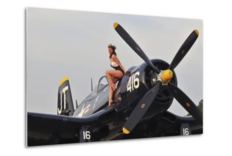 1940's Style Navy Pin-Up Girl Sitting on a Vintage Corsair Fighter Plane--Metal Print