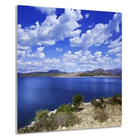 Tranquil Lake Against Cloudy Sky, Sardinia, Italy--Metal Print