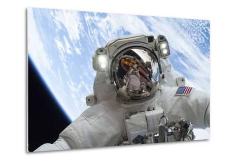 Astronaut Participates in a Spacewalk--Metal Print