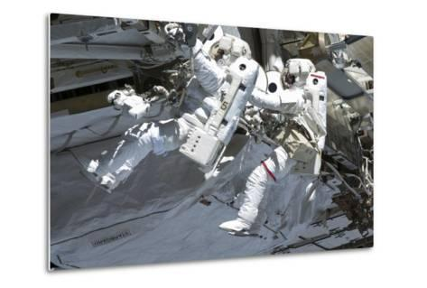 Astronauts Participate in a Spacewalk on the International Space Station--Metal Print