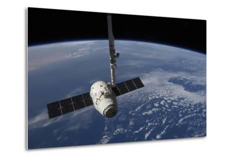The Spacex Dragon Cargo Craft Prior to Being Released by the Canadarm2 Robotic Arm--Metal Print