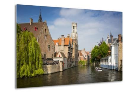 Tourist on Boat Ride Through the Canals of Bruges, Belgium-Brian Jannsen-Metal Print