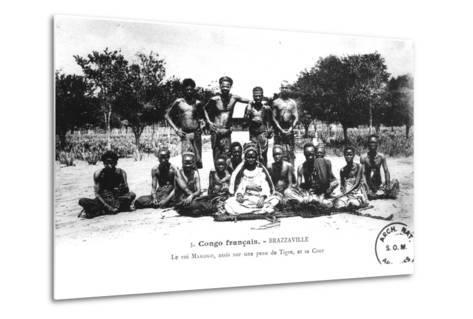 King Makoko, Seated on a Tiger Skin, and His Court, in Brazzaville, French Congo--Metal Print