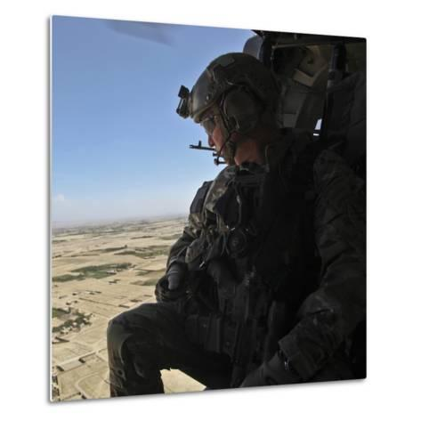 A U.S. Army Special Forces Soldier Looks Out from a Uh-60 Black Hawk--Metal Print