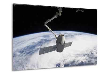 Spacex Dragon in the Grasp of Canadarm2--Metal Print