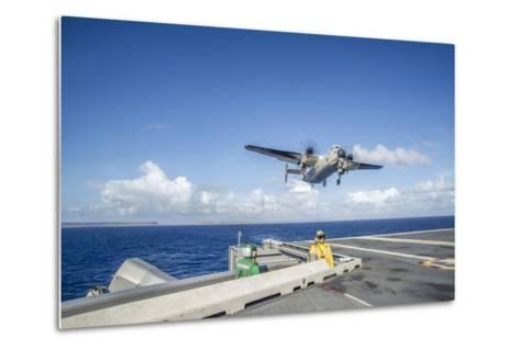 A C-2A Greyhound Carrying Relief Supplies--Metal Print