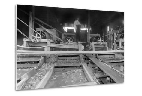 A Worker Stands over a Rock or Gravel Processing Facility, Ca. 1910--Metal Print
