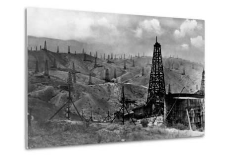 Oil Rigs Near Taft, California--Metal Print