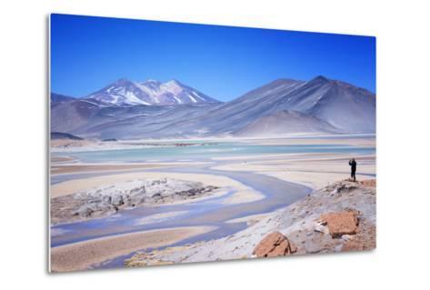Man Standing on Rocks Looking over Miscanti Laguna, Turquoise Mineral Lake, San Pedro De Atacama-Kimberly Walker-Metal Print