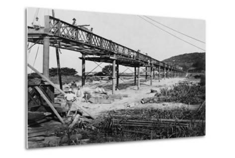 Men Build a Railway Bridge--Metal Print