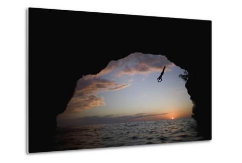 Young Man Diving into Sea at Pirate's Cave-Paul Souders-Metal Print