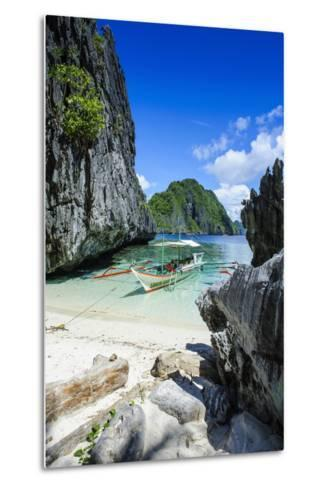 Outrigger Boat on a Little White Beach and Crystal Clear Water in the Bacuit Archipelago-Michael Runkel-Metal Print