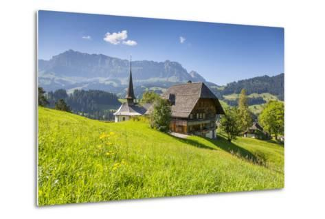Church and Farmhouse in a Village in the Emmental Valley, Berner Oberland, Switzerland-Jon Arnold-Metal Print