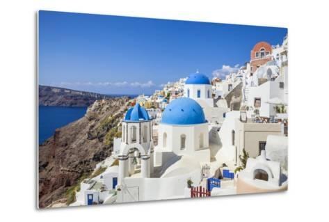 Greek Church with Three Blue Domes in the Village of Oia-Neale Clark-Metal Print