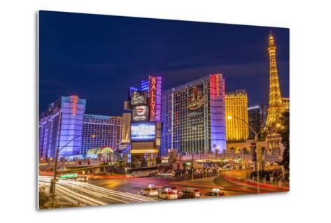 Neon Lights on Las Vegas Strip at Dusk with Car Headlights Leaving Streaks of Light-Eleanor Scriven-Metal Print