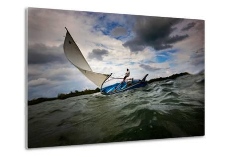 A Man Sails a Boat Off the Cayman Islands in the Caribbean-Chris Bickford-Metal Print