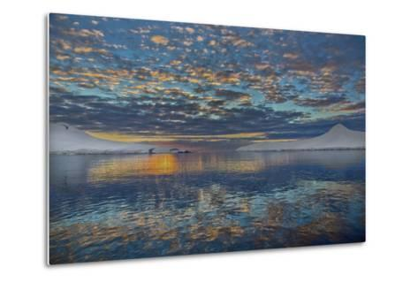 A Beautiful Seascape of Puffy Little Clouds Reflected in Icy Water at Sunset-Ira Meyer-Metal Print