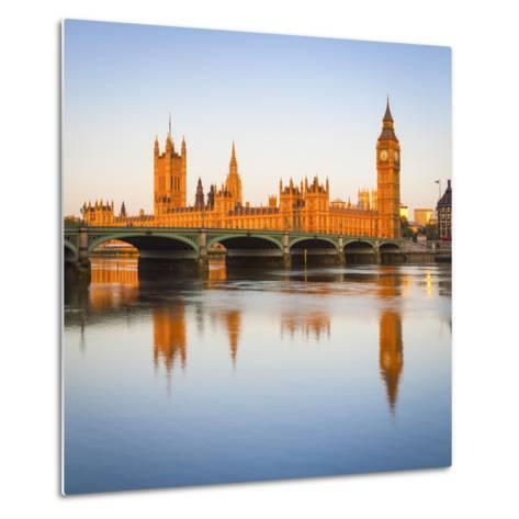 The Houses of Parliament and the River Thames Illuminated at Sunrise.-Doug Pearson-Metal Print