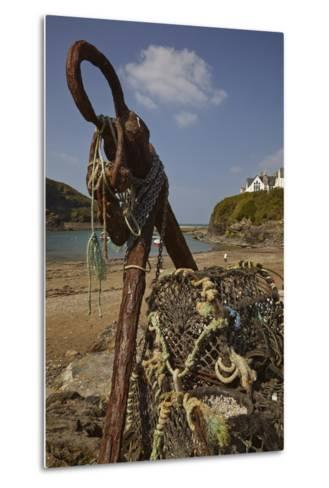 An Old Anchor Next to Crab Pots Piled Up Beside the Harbor in Port Isaac, Near Padstow, Cornwall-Nigel Hicks-Metal Print